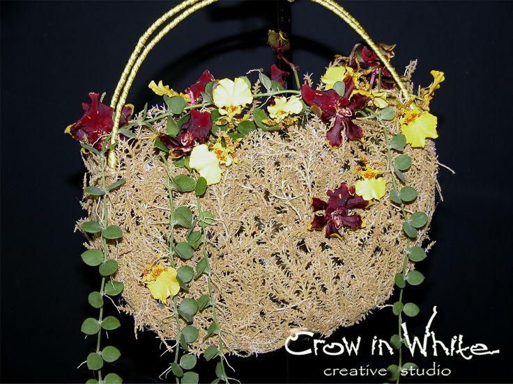 Wedding arrangement in a basket. Glariosa, orchid and greens