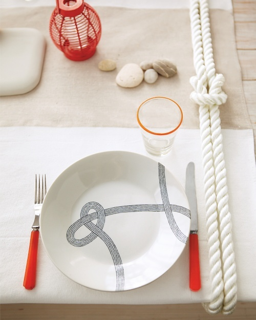 This nautical table setting from Martha Stewart will look great for a 4th of July party with it's red, white and blue tones.