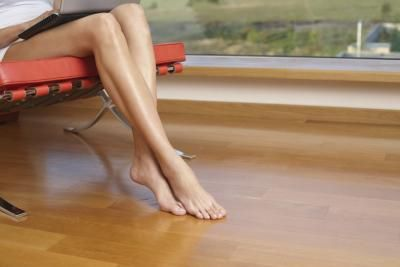 Hardwood floors are subjected to wear and tear from foot traffic over the years and require some type of protective coating to help the color and wood remain in good condition. While chemical sealers ...