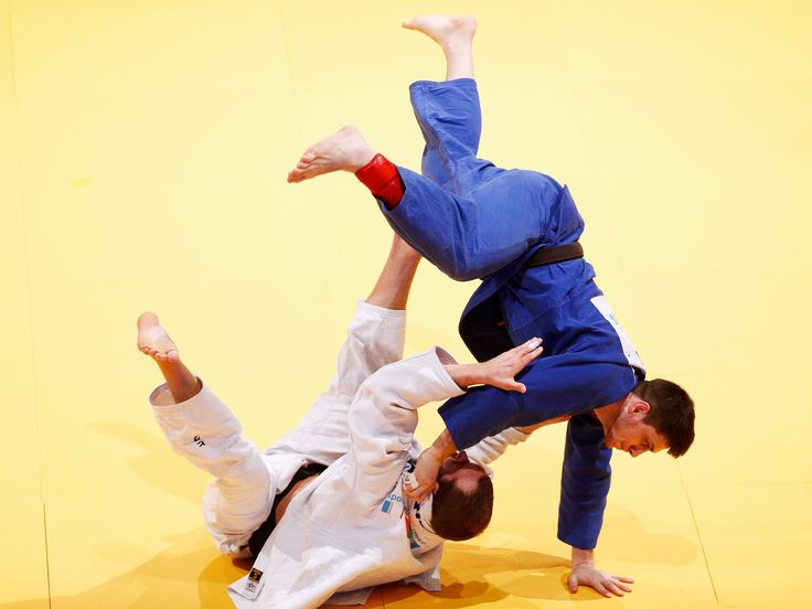 Martin Pacek, bottom left, of Sweden and Adlan Bisultanov of Russia compete during the Dusseldorf Judo Grand Prix in their mens -100kg bronze medal match held at Mitsubishi Electric Halle in Dusseldorf, Germany. Dean Mouhtaropoulos, Getty Images