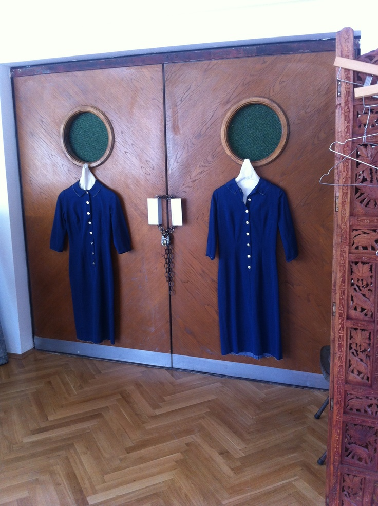 organic denim dress in couple sizes hanging by the elevator