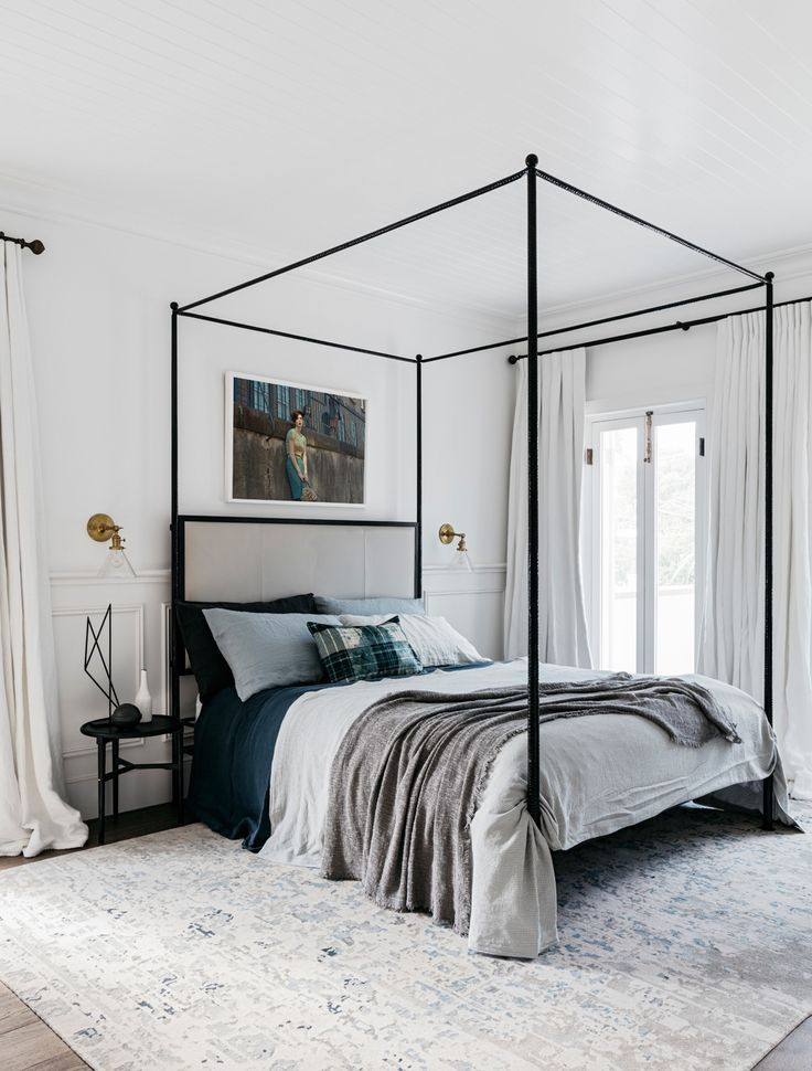 The design team continued their classic meets beach-casual approach with vintage fixtures, fittings, and detailing, set against a sea of white walls, beadboad ceilings, and billowing white curtains. Sydney Vacation Home by Alexander & Co.