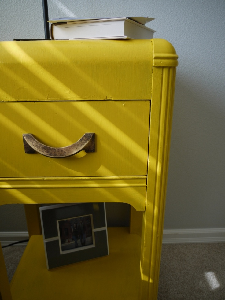 fresh coat of paint on a goodwill find...perfect for a yellow/grey themed room.