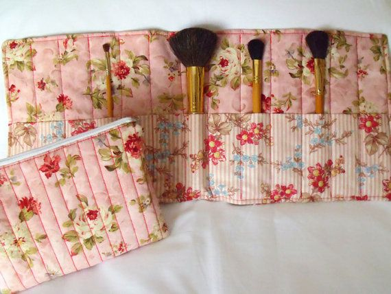 Cosmetic gift set, make up brush holder and zipped cosmetic bag. A great gift idea. Brushes and cosmetics not included. Sewn with pink floral and striped cotton fabric and contrasting stitching. Fully lined quilted cosmetic bag. Make up brush roll is quilted using cotton wadding with cream grosgrain ribbon ties. The size of the brush roll is aprox 20 x 8.5. It has 13 slots measuring 4 cms wide. The cosmetic bag measures aprox 7.5 wide by 6 high. Machine washable. 100% cotton. Any questions…