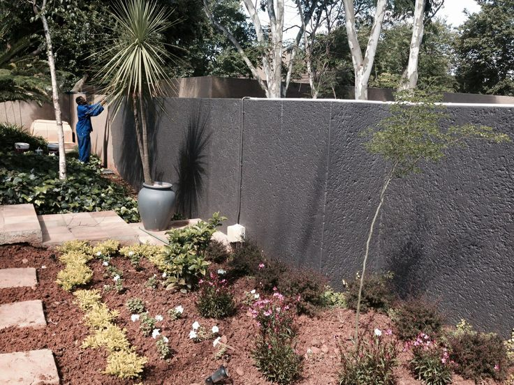 Boundary wall being painted.
