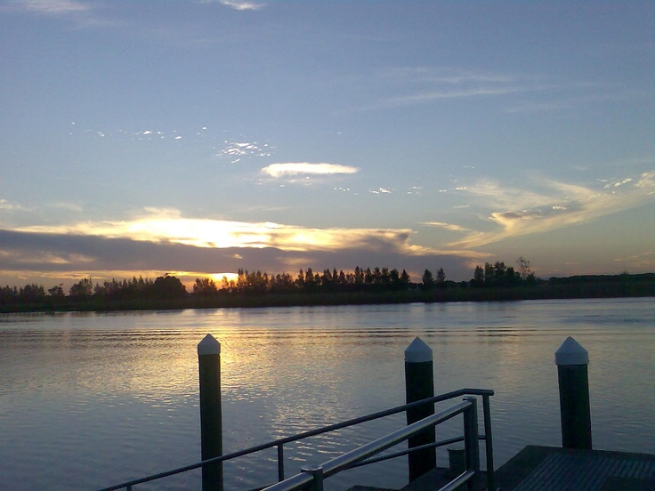 Sunset on the Williams River at Raymond Terrace just over the Hexham bridge, heading north from Newcastle NSW