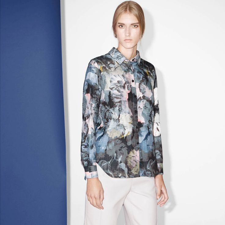 FWSS Out Getting Ribs is a loose-fit shirt in a soft viscose mix. Button stand at front, overlapping panels and a slit opening detail at back.  #floral #print #shirt #detail #fwss