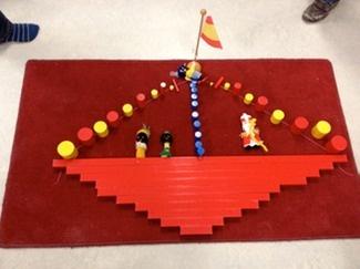 * Stoomboot van rode stokken...dit kan je natuurlijk ook laten doen met blokken!