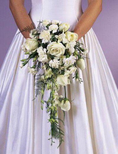 Image from http://cherrymarry.com/wp-content/uploads/2012/01/cascade-hand-wedding-bouquet-e1326883025867.jpg.