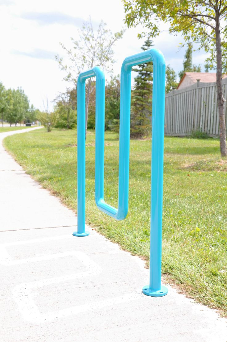 Canaan's bike rack, CAH 701, in a bright blue. Perfect for brightening up dull playgrounds or schoolyards!