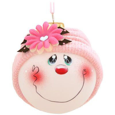 """Featuring the heart-warming artistry of Pam Chatley, this adorable Blossom SockHead™ glass ornament is artfully infused with home-spun charm.  Blossom's sweet face includes two hand-painted soulful eyes, a button nose and a whimsical grin all framed by a pretty pink knit hat adorned with silk flowers and a decorative bow. Coming ready to hang with a pink ribbon, this 3¼"""" round frosted glass ornament is positively blooming with personality! ©Chatley. Made in the USA."""