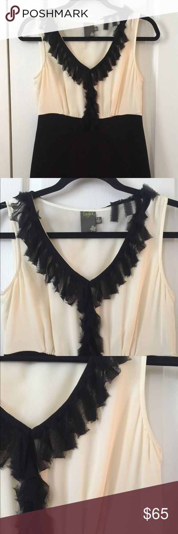Nordstrom brand black and cream party dress Super cute sleeveless color block Taylor dress with detailed ruffles on neck.  Straight fit. Heavy knits Teri also. Worn only once. No flaws or damage. Taylor Dresses