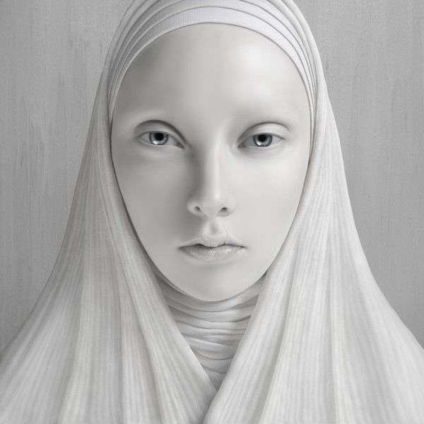 Oleg Dou: Nuns: Nun 2  I once saw an odd photograph with the sun-tanned face of a nun standing  out amongst a background of snow-white clothing. It had a bizarre  impression on me and inspired me to create an entire series of works