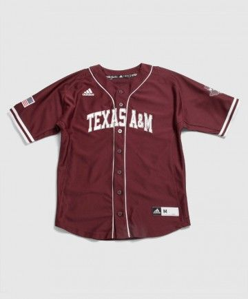 This replica of the Aggie baseball teams jersey features Texas A&M on the front in stitched silver with white cloth middle. The right sleeve has the United States flag on it and the left sleeve displays the state of Texas with the block T and star on the sleeve.