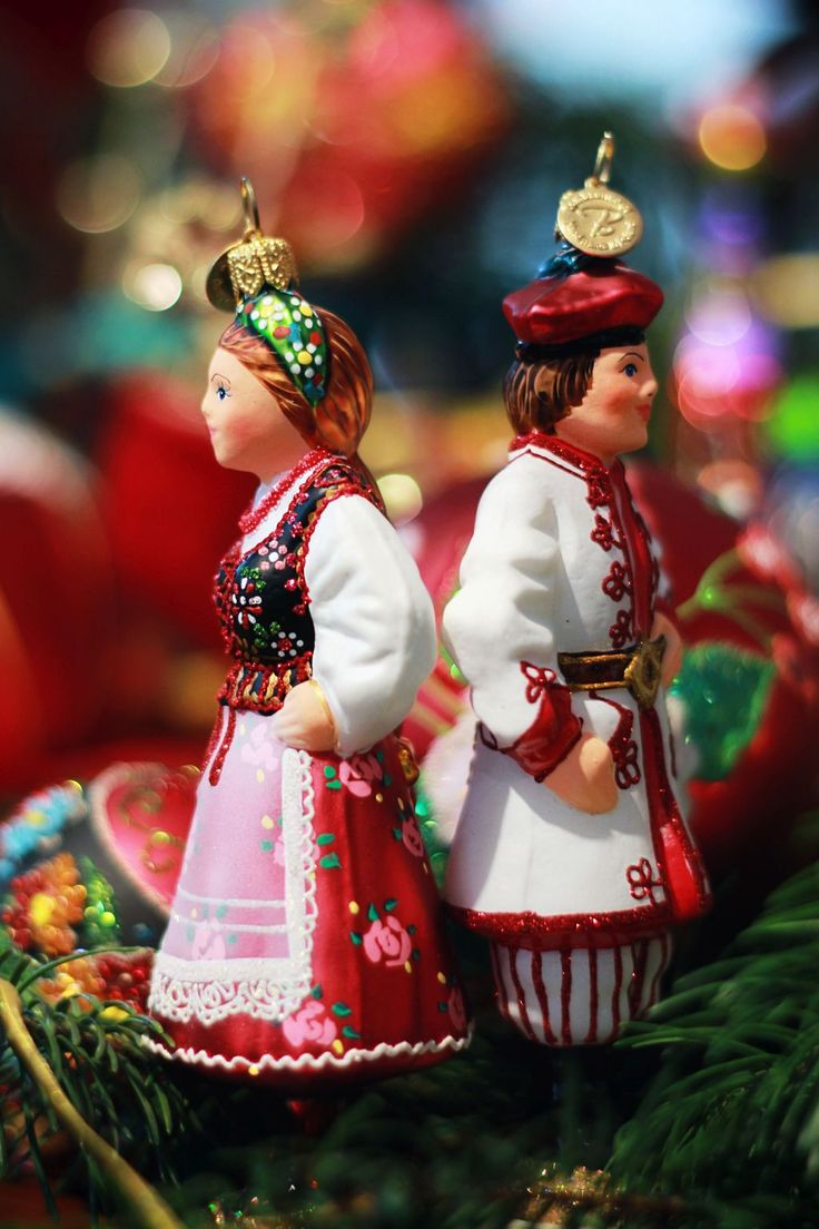 Polish, glass, mouth blown and hand-decorated baubles in the shapes of a couple in traditional Cracow costumes. Available here: http: bombkarnia.pl/en/christmas/polish-costium