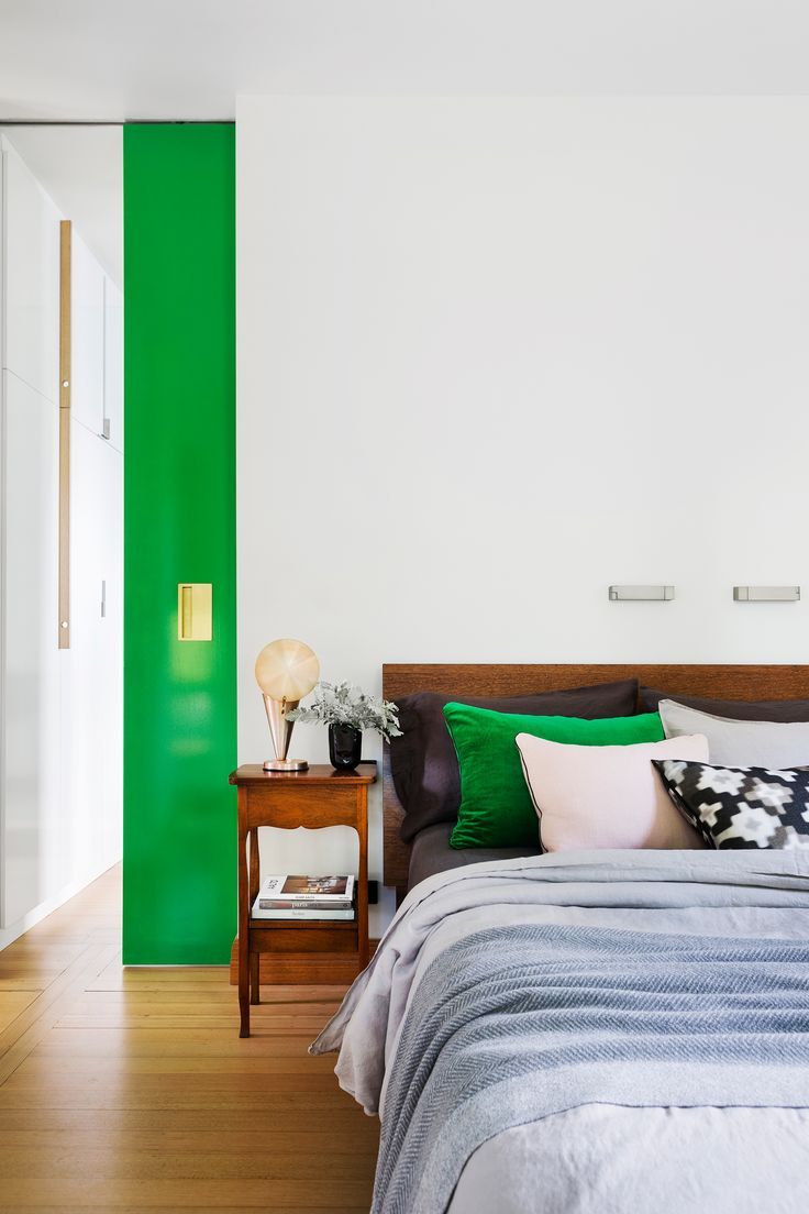 Citrus colours in this bedroom add zing against the clean, neutral palette used throughout the rest of this renovated Melbourne home. Photography: Martina Gemmola   Styling: Toni Briggs   Story: Australian House & Garden.