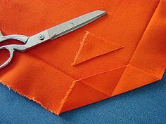 How to cut end for sewing corners on a tablecloth or any square to make it lay flat and neat. Hamburgerpanda website.Cotton duck makes good fabric.