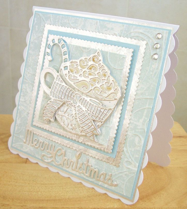 A 'frosty' version of the Rococo cocoa cup die - details are here - http://anotherdayanothercard.blogspot.co.uk/2014/08/rococo-hot-cocoa.html
