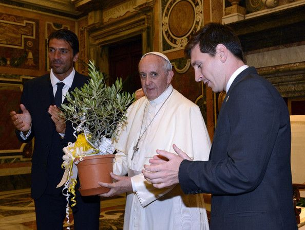 Pope Francis exchanges gifts with Gianluigi Buffon of Italy and Lionel Messi of Argentina (R) during a private audience at The Vatican on August 13, 2013 in Vatican City, Vatican.