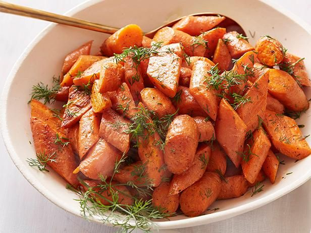 Get Roasted Carrots from Ina Garten.  I added a little balsamic vinegar.  Didn't use dill.  Very good.