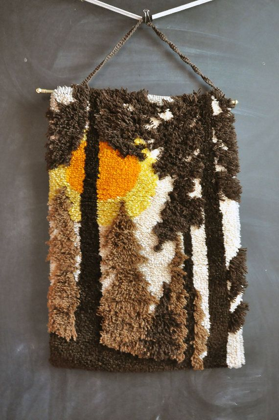 Love the different lengths of yarn used to create depth in this latchhook rug.