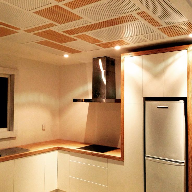 Custom built kitchen with feature ceiling