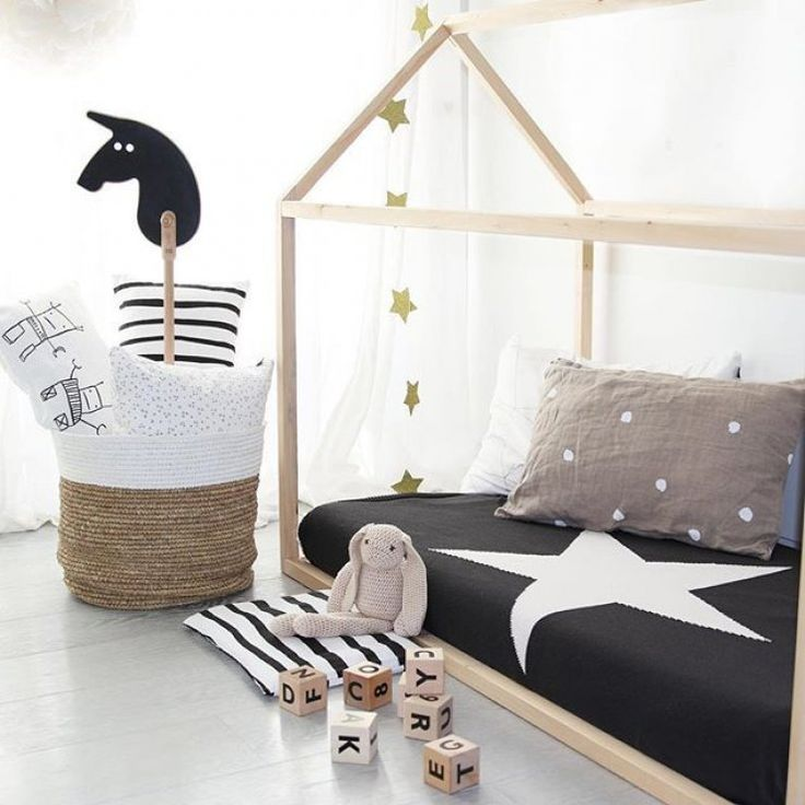 Black and white with natural tones for a kids room
