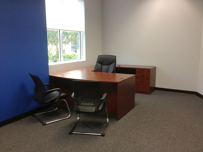 traditional and functional office furniture pieces were used to fill the space with all essentials p