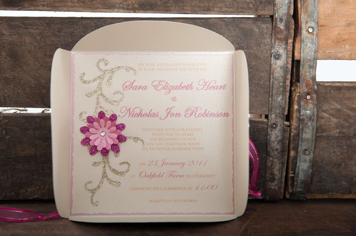 Dainty, pink and gold petal fold wedding invitation with shaded pink 3D flower and gold glitter flourish
