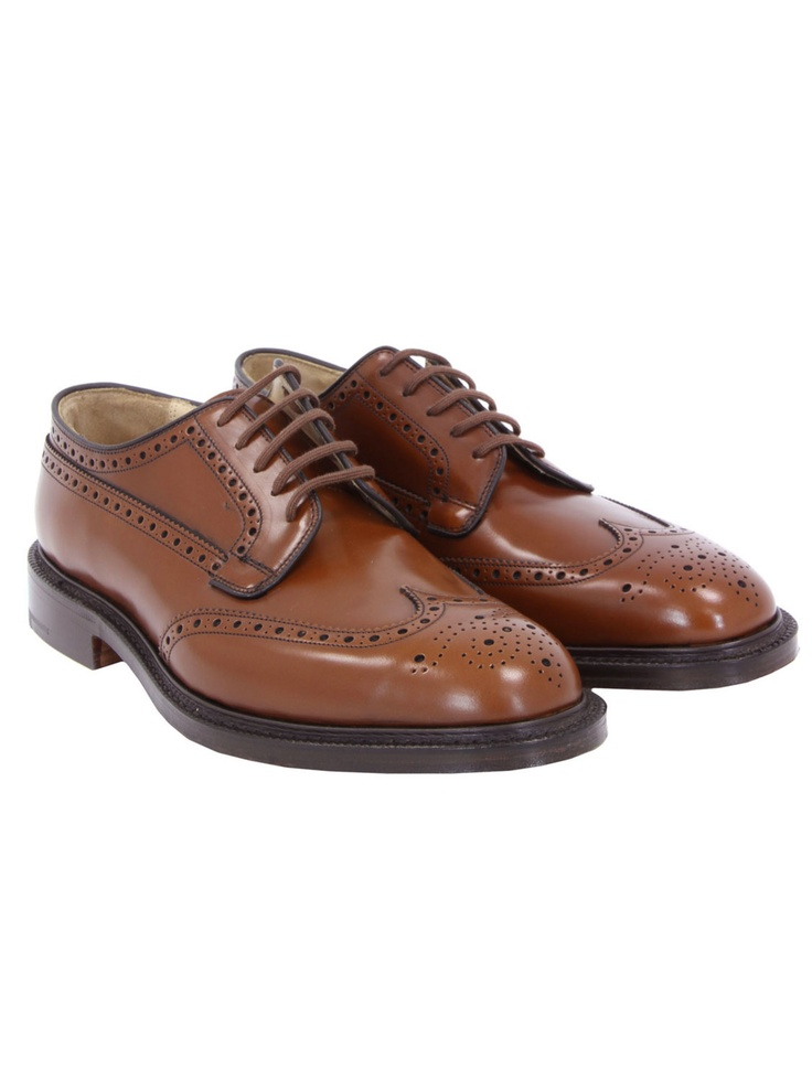 Church's £390 at Coggles.com– Grafton, mens hand crafted, sandalwood brown polished binder leather wingtip Oxford brogues with exaggerated punching detail and a rounded toe. The shoes are Goodyear welted with rolled laces, embossed Church's leather insole, stacked 3cm heel and a polished leather sole. Each shoe lining features a hand written style name and code.