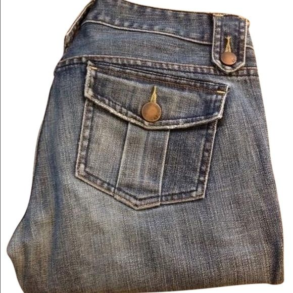 Armani Exchange Boot Cut Denim Comfortable and booty flattering denim from A|X. Button flap pockets in the back and buttoned belt loop detailing around the waist. 99% cotton 1% spandex. Armani Exchange Jeans Boot Cut