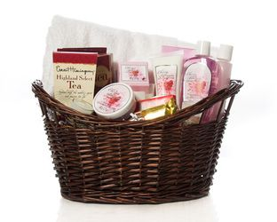 """Pamper Yourself"" Basket      A Lush Towel, Candles and Bath Products.  Tea, Gourmet Hot Cocoa and Chocolates.    Perfect For A Night Of Relaxing In The Tub    $75.00 CAD"