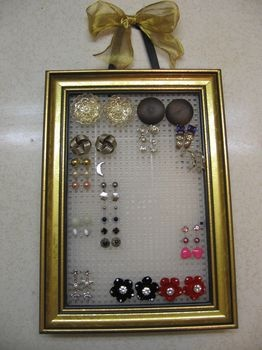 Stud earring organiser.  Old frame, plastic canvas.  Voila.