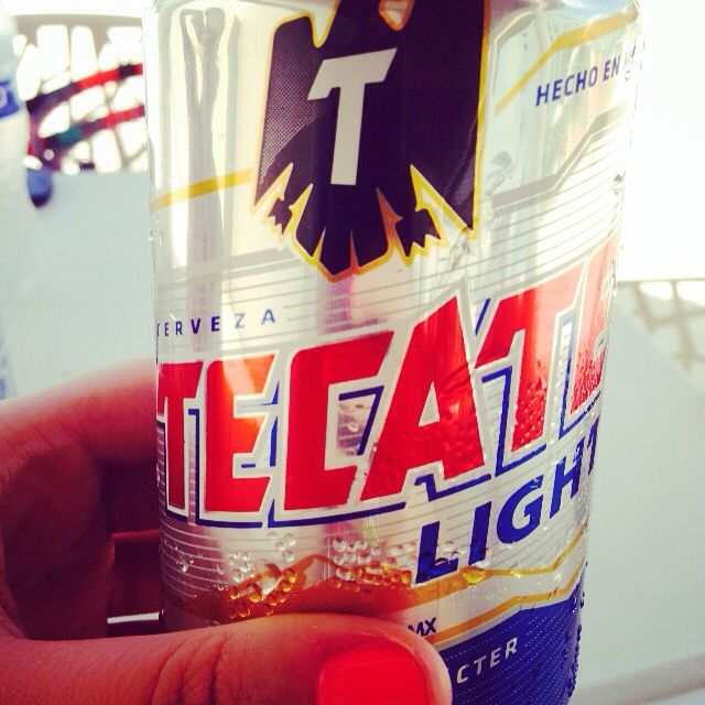 Nothing like an iced cold Tecate to cool down! #Tecate #beer #beach #pool #travel #vacation #mexico #cancun