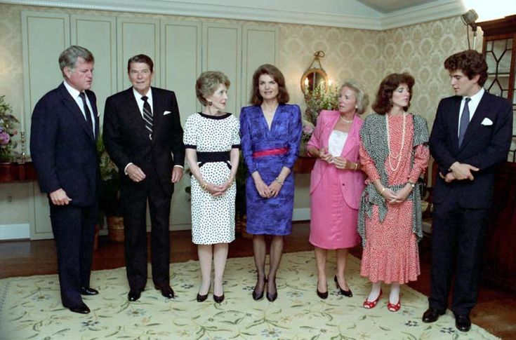 President and Nancy Reagan talking to the Kennedy family