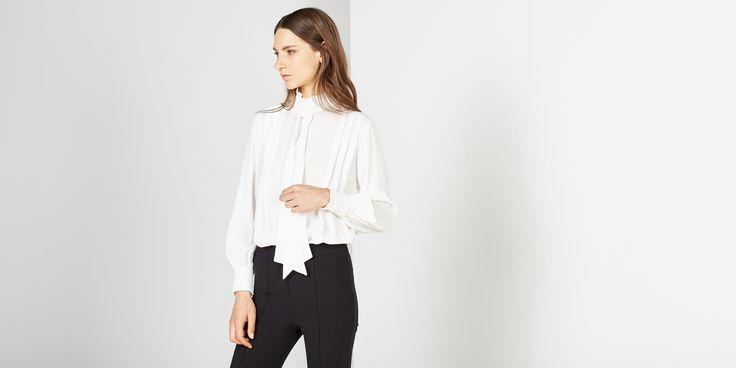 Sfera.com - Camisa de tablas con manga larga abullonada. Cierre de botones trasero. Detalle de lazo. http://www.sfera.com/es/mujer/camisas-blusas-y-tops/blusas/camisa-tablas-66d57k2/21297/