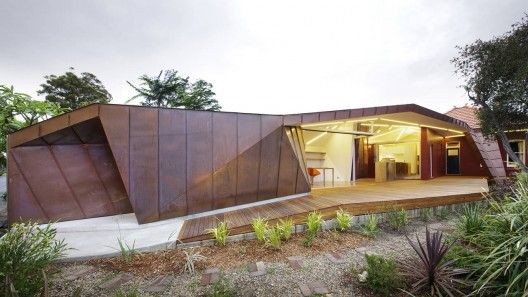 This 'Extension to a Small Cottage' by Innovarchi architects in Sydney is made up of standing seam copper and the pitched roof as required by council. This reminds me of a house by Chenchow Little which dealt creatively with the same codes.