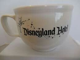 """Disneyland Hotel Stromboli's Ristorante Jumbo Mug made by Homer Laughlin China Company. Features lettering 'Disneyland Hotel' and Tinkerbell graphic on one side of the cup with lettering 'Stromboli's Ristorante' on reverse side. The mug is approximately 3 1/2"""" high and 4 1/2"""" in diameter at the top. Stromboli's operated at the Disneyland Hotel from September 1995 until April 1999. It replacedthe Cafe Villa Verde Restaurant and, in turn, was eventually replaced by Goofy's Kitchen 
