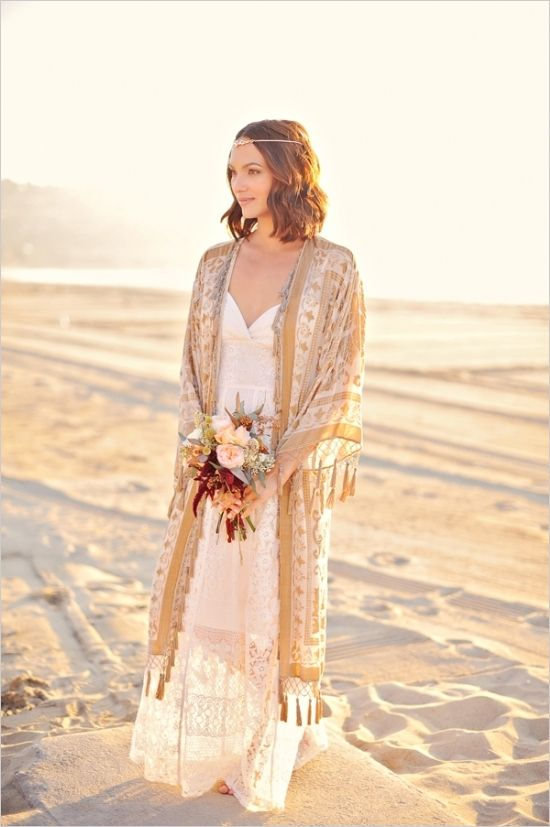 beautiful gold bohemian kimono for relaxed bridals #bridals #bohemianbride #weddingchicks http://www.weddingchicks.com/2014/04/04/sun-kissed-romantic-wedding/