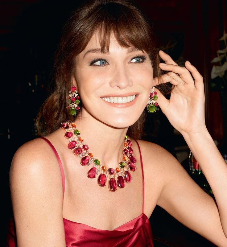 Carla Bruni wearing the Bulgari Diva high jewellery necklace in pink gold for the Italian jeweller's new ad campaign, set with 471.07 carats of rubellite, peridot, garnet and diamonds, and earrings featuring peridots, rubellites and diamonds. Discover the history of Bvlgari and the iconic women who have worn the jewellery: http://www.thejewelleryeditor.com/jewellery/bulgari-history-of-style-celebrities-iconic-design/ #jewelry