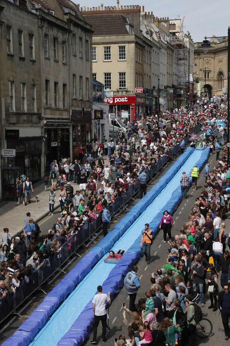 On May 4, Park Street in Bristol was turned into an enormous, 250-foot water slide. | The 19 Most Delightful Pictures From That Giant Pop-Up Water Slide In Bristol
