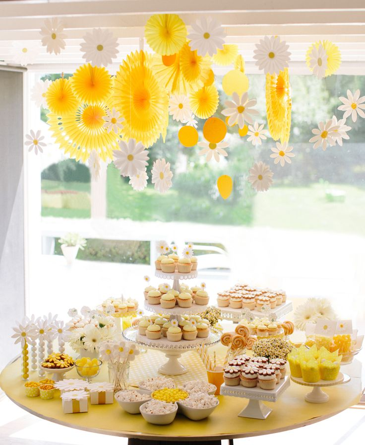 we're obsessed with this Daisy Party by Darcy Miller. What a beautiful unisex baby shower idea.