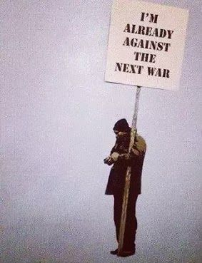 """I'm already against the next war""  Artist: Banksy"