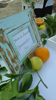 A refreshment table styled with orange and olive as the theme - by islandevents.gr