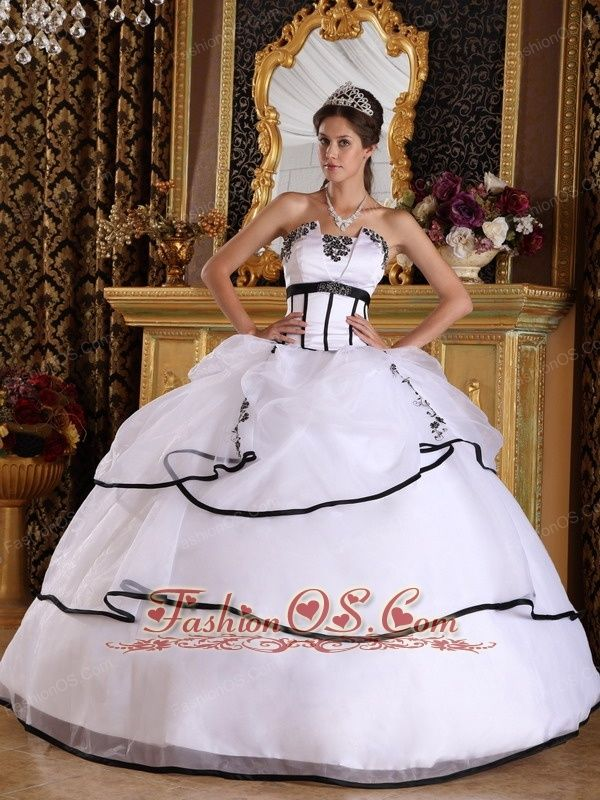 Elegant White Quinceanera Dress Strapless Satin and Organza Appliques Ball Gown  http://www.fashionos.com  White and black always are great match. This didtinctive quinceanera dress has a special neckline ensrusted with intricate beading. Highlighted with the contrasting colors, the dress is full of drama. With the first later of the dress adroned with pick ups and tiny applique, the dress looks even prettier.