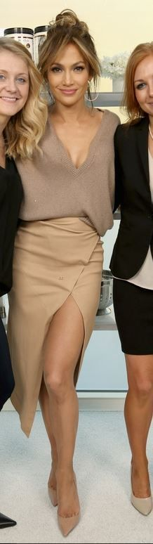 Jennifer Lopez's tan wrap skirt, nude pumps, and brown sequin v neck sweater