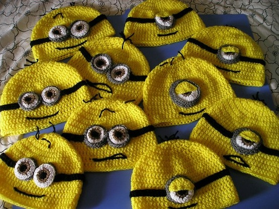 Minion beanies! Minion beanies! Minion beanies! if i ever did a despicable me floor theme i would take up knitting to make everyone one of these lol