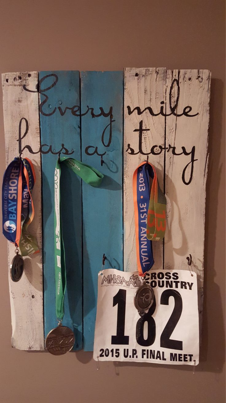 Every mile has a story turquoise pallet wood medal display by AnnGeeWoodSigns on Etsy