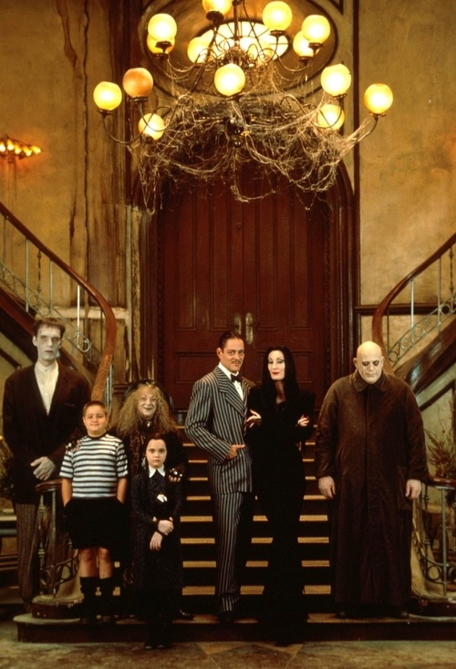 The Addams Family, directed by Barry Sonnenfeld.   http://en.wikipedia.org/wiki/The_Addams_Family_%28film%29