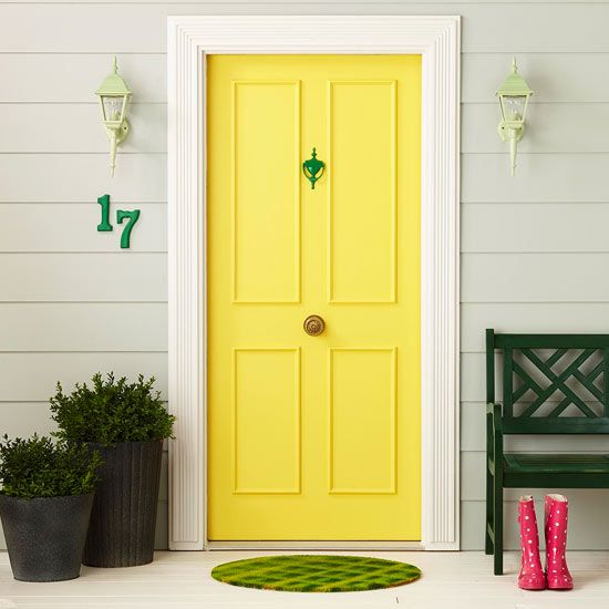 Refresh Tired Fixtures-Don't let old fixtures leave your facade feeling flat. Paint perks up an exterior for much less than the cost of new fixtures. Freshen a flea market metal door knocker with a paint designed for metals. Lights get a bright coat to tie in the yellows and greens of the rest of the porch.
